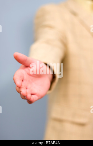 A businessmans outstretched hand - Stock Photo