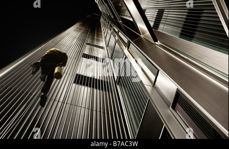 Facade cleaner climbing the side of a skyscraper, image editing, in Frankfurt am Main, Hesse, Germany, Europe - Stock Photo