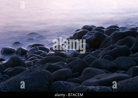 Evening mood on the coast, lava rocks on a beach, time exposure, La Palma, Canary Islands, Spain, Europe - Stock Photo