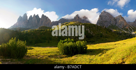 Peaks of the Geisler mountains on the Seceda High Plateau near Regensburg Hut in the evening light, Puez-Geisler - Stock Photo