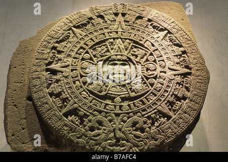 Aztec or Mexica Stone of the Sun with the sun god Tonatiuhin in the center at the National Museum of Anthropology - Stock Photo