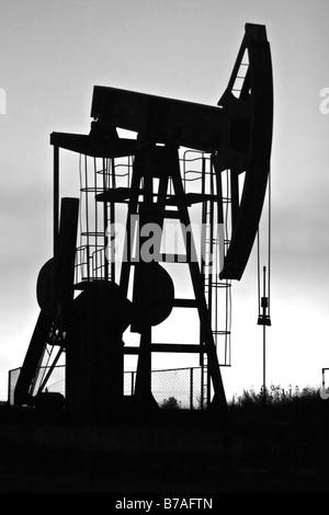 industrial pump jack silhouette b&w - Stock Photo