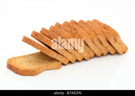dry toasted bread loaf in slices isolated on white background - Stock Photo