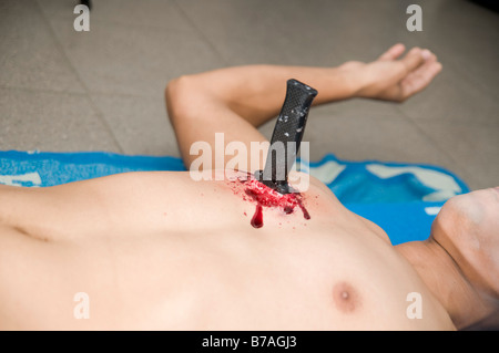 Knife stab injury in a male chest Mock up with make up - Stock Photo
