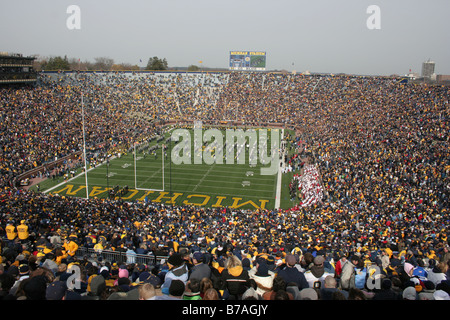 Fans pack the University of Michigan football stadium for a college football game. - Stock Photo