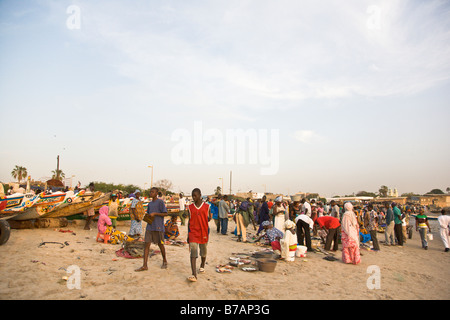 This beachside fish market in Senegal's capital city of Dakar is a typical scene in this coastal West African country. - Stock Photo