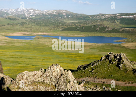Black Lake in Kanas national park in Xinjiang in China. - Stock Photo
