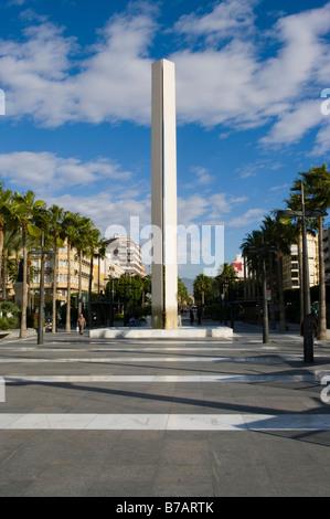 Monument On The Reina Regente Almeria Spain Spanish Palm Tree lined avenue - Stock Photo