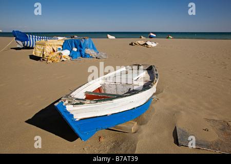 Fishing boats on the beach in Fuengirola Malaga sun coast Andalusia Spain - Stock Photo