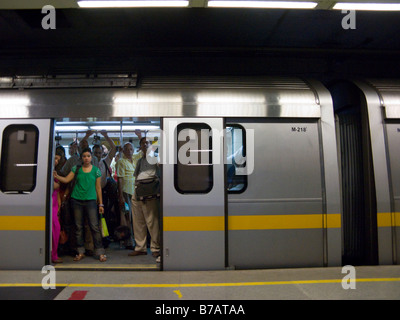 A yellow line tube train carriage interior with passengers delhi stock photo royalty free - Carrage metro ...