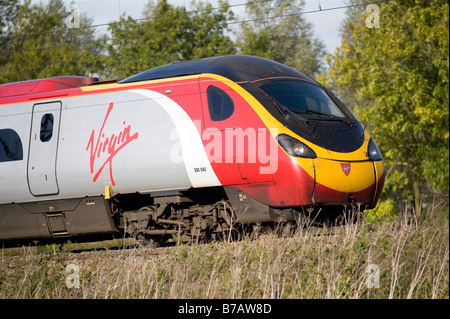 Virgin Class 390 Pendolino train travelling at speed through the english countryside on the West Coast Main Line - Stock Photo