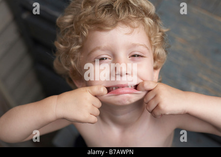 Little Boy Making Faces - Stock Photo