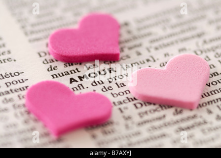 Heart Shapes Framing Dictionary Word Amour - Stock Photo