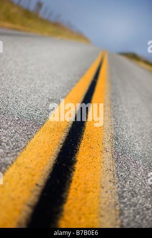 Close-up of Double-Yellow Line on Rural Highway, Santa Cruz, California, USA - Stock Photo
