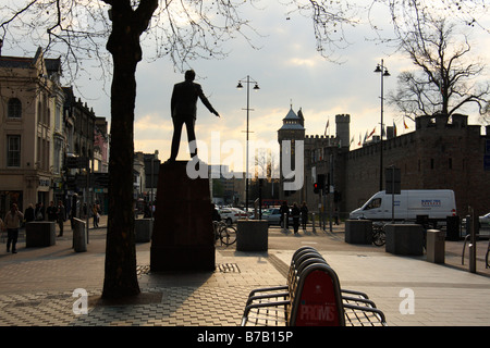 Cardiff Castle in the background, with statue of Aneurin Bevan in the foreground, Cardiff, South Wales, U.K. - Stock Photo