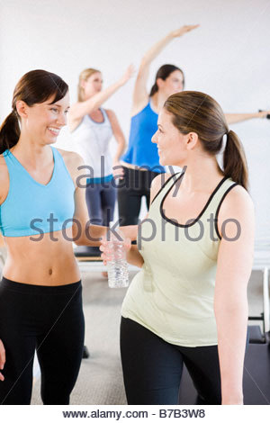 Women in sportswear talking at the gym - Stock Photo