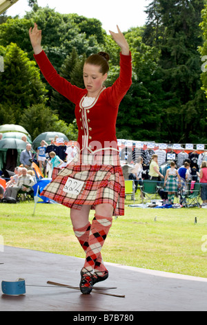 Scottish Highland Games - female dancers in kilt and wearing plaid performing reel Individual assessment at Strathmore - Stock Photo