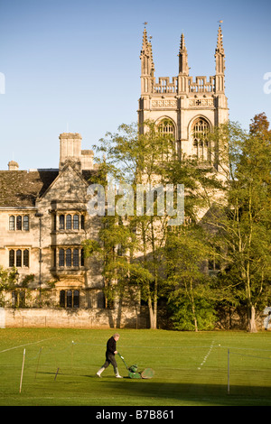 Groundsman cuts the cricket pitch grass beside Merton College, Oxford, England, UK. - Stock Photo