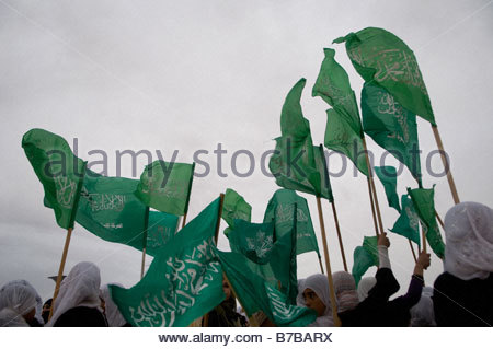 Bedouin women wave green Islamic flags in the Negev village of Ar'arat an-Naqab during a protest against Israel's - Stock Photo