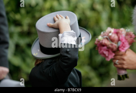 A page boy holds on to his top hat at a wedding in Bromsgrove Worcestershire UK - Stock Photo
