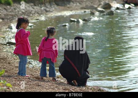 muslim mother and daughters, Rutland Water, England, UK - Stock Photo