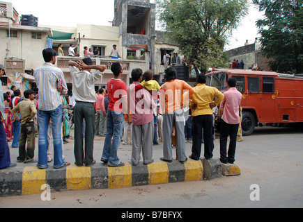 People watching a fire scene in Ahmedabad, India. - Stock Photo