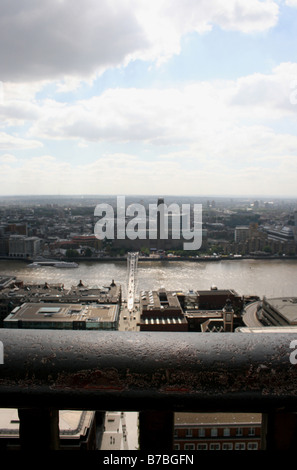 Tate Modern and the Millennium Bridge viewed from St Paul's cathedral. London, England - Stock Photo