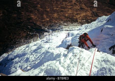 Winter climber on Buachaille Etive Mor in Glen Coe, Scotland - Stock Photo
