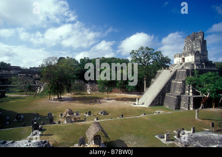 The Great Plaza and Temple II or Temple of the Masks at the Mayan ruins of Tikal in Tikal National Park, El Peten, - Stock Photo