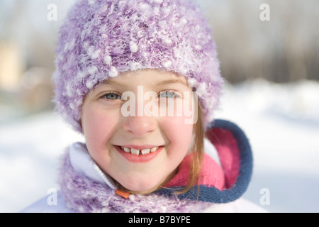 Portrait of 9 year-old girl outdoor in winter, Winnipeg, Canada - Stock Photo