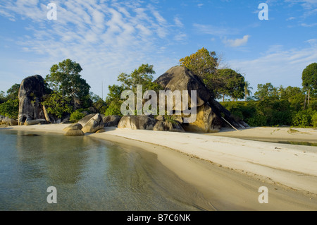 Big granite boulder in white sandy beach of Belitung Island - Stock Photo