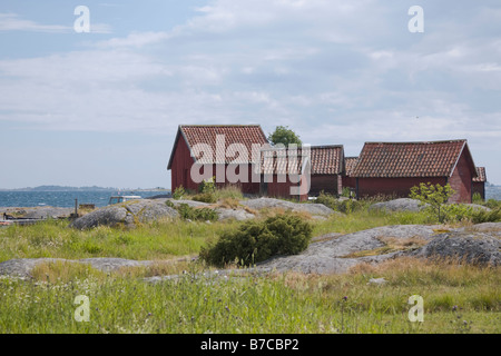 Traditional red painted fisherman's huts on the island of Svartloga in the 'Archipelago of Stockholm', Sweden - Stock Photo