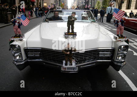 Veterans of American wars in their open top classic American car partake in the Veterans Day Parade in Manhattan, - Stock Photo