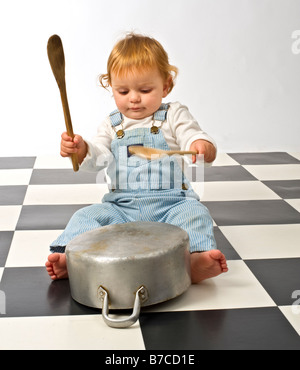 little boy druming playing with pots - Stock Photo