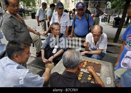 Xiangqi Game, Columbus Park, Chinatown, New York City, USA - Stock Photo
