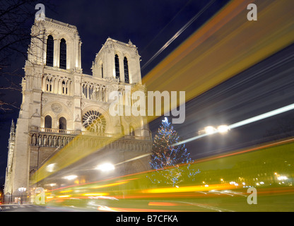 The cathedral of Notre Dame with Christmas tree and decoration in central Paris, France. - Stock Photo