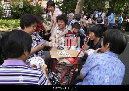 Card Game, Columbus Park, Chinatown, New York City, USA - Stock Photo