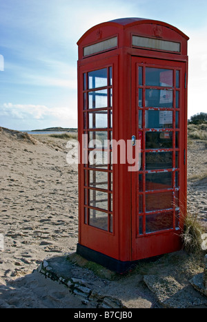 Telephone Box on beach at Studland - Stock Photo