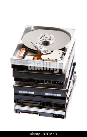 pile of open computer hard drives on a white background - Stock Photo