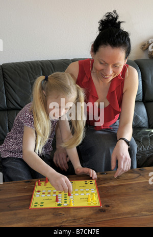 mother with child, playing Don't Worry - Be Happy - Stock Photo