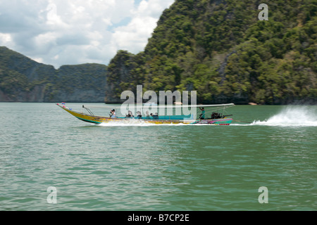 Long-tail boat on Lake Cheow Lan, Thailand, Phuket, Khao Sok National Park - Stock Photo