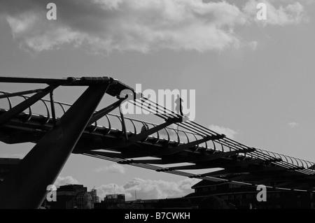 Workman on the Millennium bridge London UK - Stock Photo