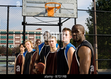 Seven basketball players in a row - Stock Photo