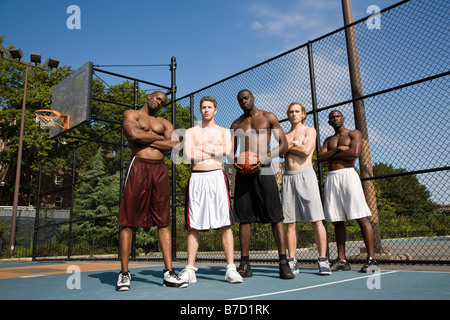 Five basketball players in a row, portrait - Stock Photo