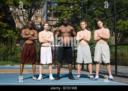 Five basketball players, in a row - Stock Photo