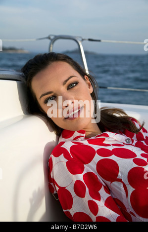 A woman relaxing on a yacht - Stock Photo