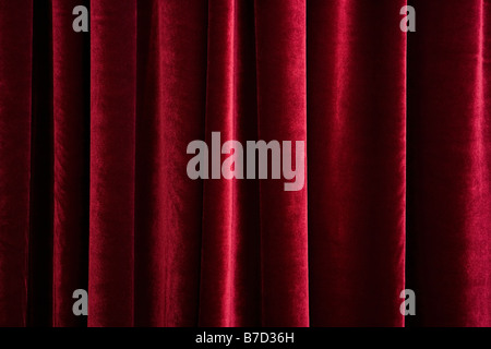 A red velvet curtain - Stock Photo