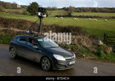 A car travelling the roads in Devon, taking pictures for future use on virtual street mapping websites or sat nav - Stock Photo