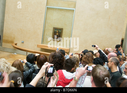 Crowd of tourists taking pictures of the Mona Lisa, Louvre, Paris, France, Europe - Stock Photo