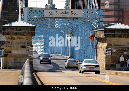 Cars cross the historic John A Roebling Bridge over the Ohio River between Kentucky and Ohio - Stock Photo